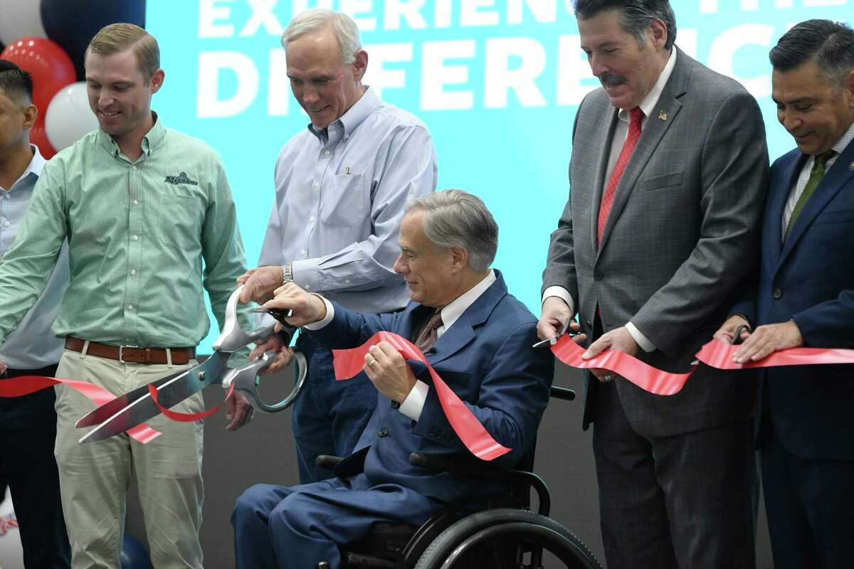 Mission Produce Steve Barnard, Gov. Greg Abbott and Mayor Pete Saenz, alongside others cut the ribbon during the grand opening of the new Mission Produce Mega Center on Wednesday, Sept. 29, 2021.