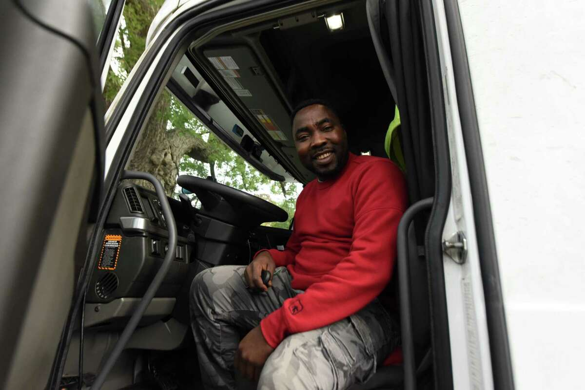 Hayeth Yacoub of Albany sits in his truck on Thursday, Sept. 30, 2021, in Albany, N.Y. The Sudanese refugee has taken up truck driving as a profession.