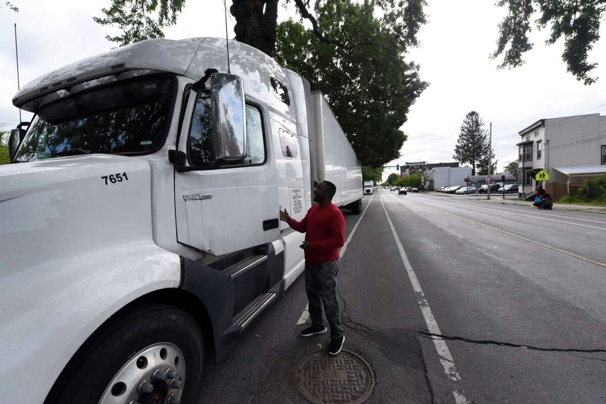 Hayeth Yacoub of Albany enters his truck on Thursday, Sept. 30, 2021, in Albany, N.Y. The Sudanese refugee has taken up truck driving as a profession.