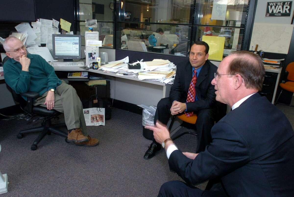 San Antonio Express-News columnist Roddy Stinson talks in his office with San Antonio Mayor Ed Garza, center, and Bexar County Judge Nelson Wolff in 2005.