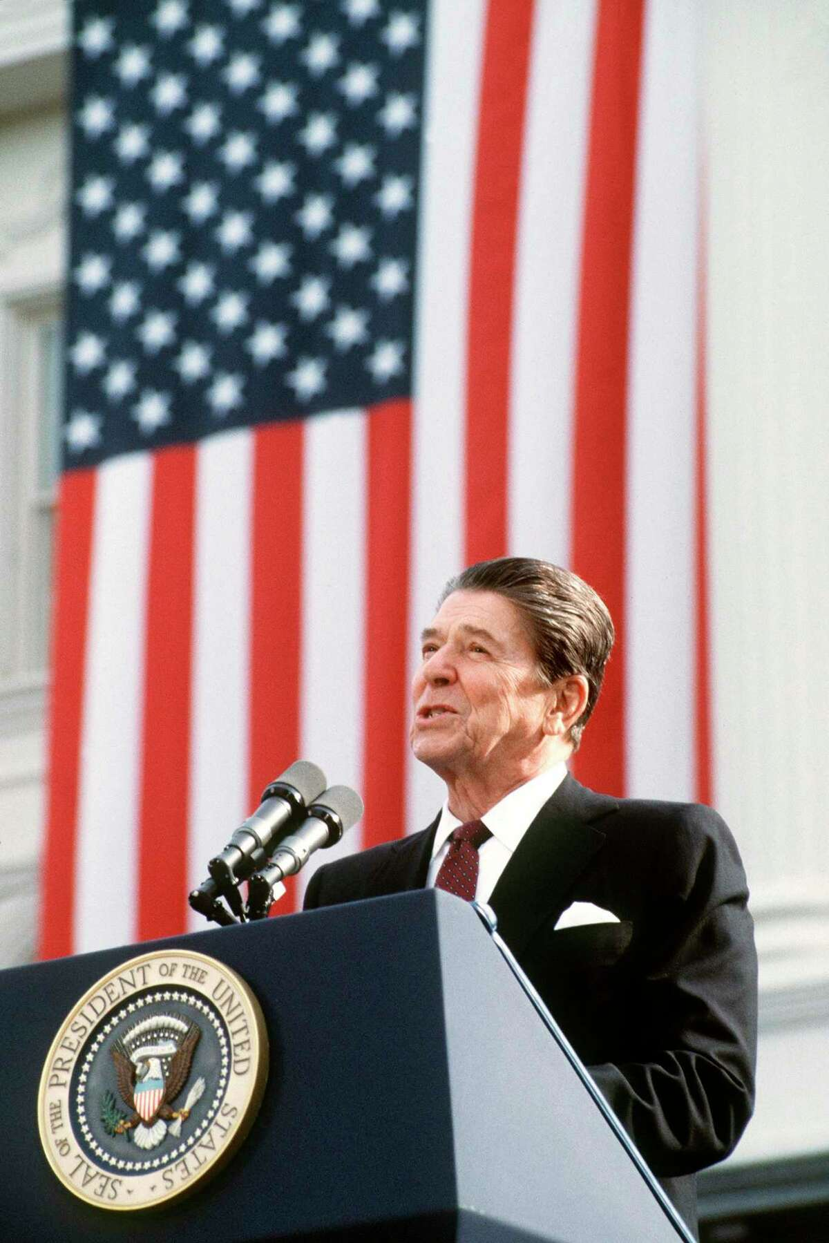 President and Republican presidential candidate Ronald Reagan addresses supporters at an electoral meeting in November 1984. (Don Rypka/AFP/Getty Images/TNS)