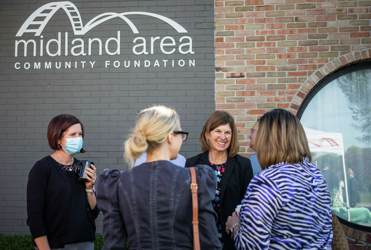 Sharon Mortensen, president and CEO of the Midland Area Community Foundation, second from right, chats with guests during the organization's Neighboring Week event Thursday, Sept. 30, 2021 in Midland. Neighboring Week, a project created by the MACF's Cultural Awareness Coalition, has been recognized as the last week in September since 2018. (Katy Kildee/kkildee@mdn.net)
