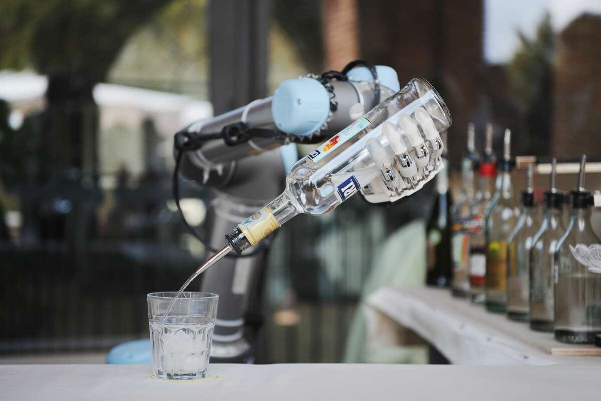 A barman robot pours a drink during the first Pisa Robotics International Festival on September 7, 2017 in Pisa, Italy.