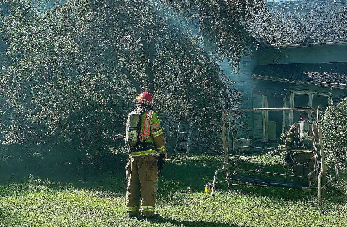 Firefighters from at least three Huron County departments battled a house fire in Elkton on Wednesday afternoon. Crews from Oliver and Winsor townships as well as Bad Axe responded to reports of heavy smoke coming from a home on York Street around 12:55 p.m. Wednesday. (Mark Birdsall/Huron Daily Tribune)