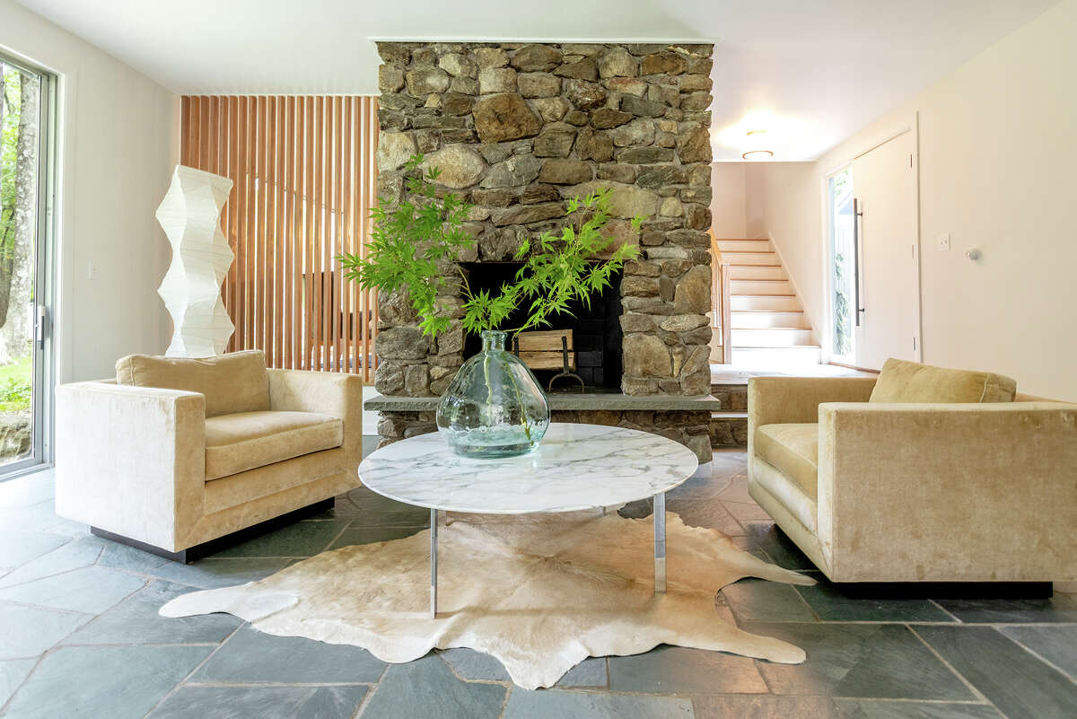 One of the fireplaces in a sitting area in thehome on 109 Sage Road in Woodbury, Conn.