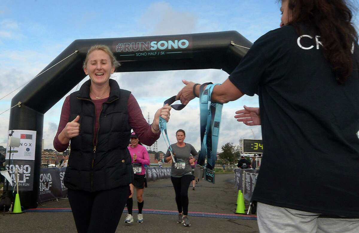 Stamford resident Stephanie McLaughlin finishes the SONO Half Marathon and 5k Saturday, October 20, 2018, in Norwalk, Conn. Over a thousand turnd out for the annual event.