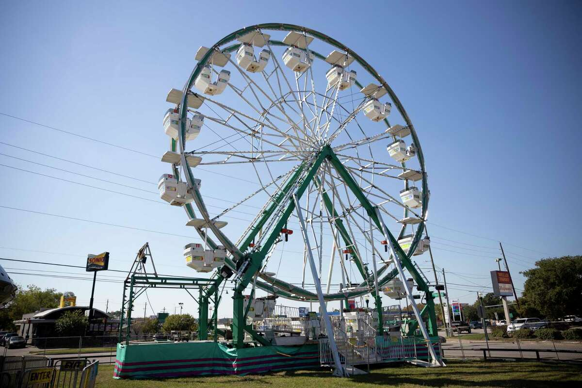 Carnival rides are set up in preparation for the 31st annual Cajun Catfish Festival in downtown Conroe, Wednesday, Oct. 7, 2020. This year's event is this Friday through Sunday.
