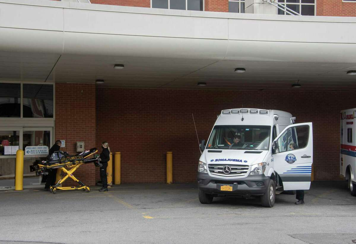 Ambulances are seen parked outside the emergency room entrance at Albany Medical Center on Thursday, Sept. 30, 2021 in Albany, N.Y.
