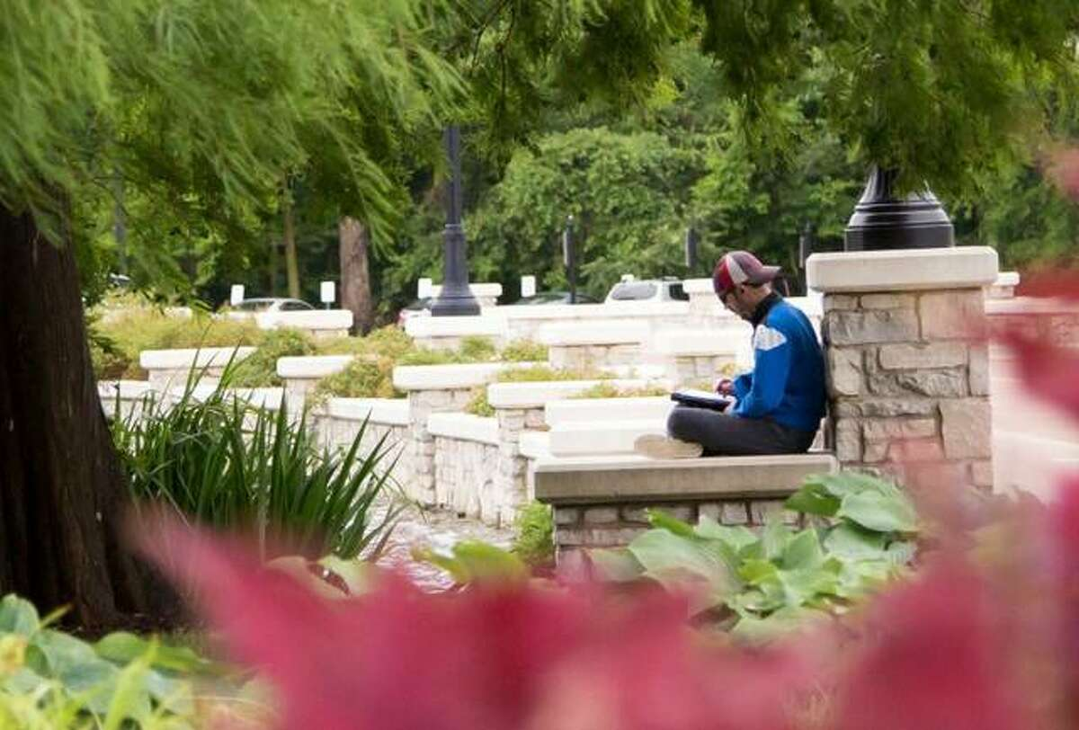 A student takes a break between classes at Lewis & Clark Community College in Godfrey in this file photo. A new study by the Northern Illinois University Center for Governmental Studies has determined Illinois community colleges have a $3.5 billion economic impact in the state.