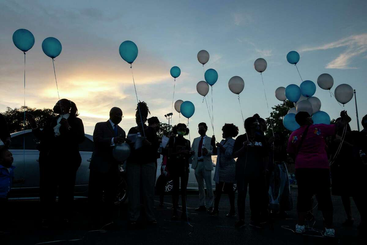 People release balloons after a vigil Wednesday held to honor of Joe Webb Sr., former District 2 councilman.