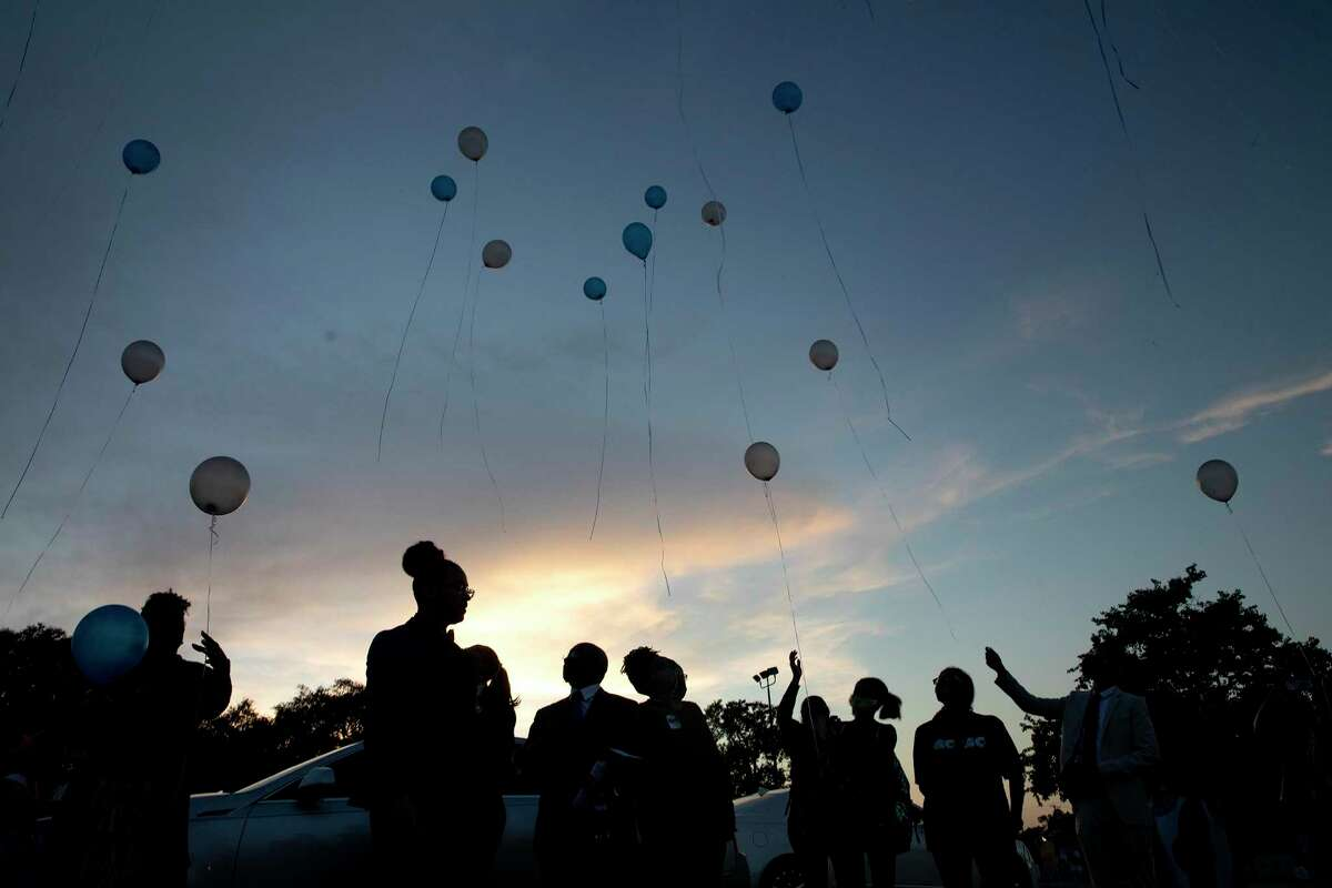People release ballots after a vigil Wednesday held to honor of Joe Webb Sr., former District 2 councilman.