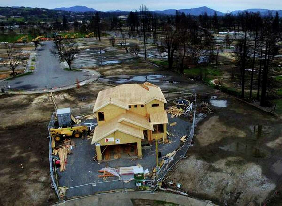 A house rises in a Santa Rosa neighborhood devastated by fire.