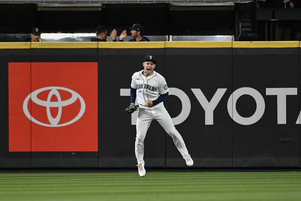 SEATTLE, WASHINGTON - SEPTEMBER 29: Jarred Kelenic #10 of the Seattle Mariners celebrates after catching the final out of the game against the Oakland Athletics at T-Mobile Park on September 29, 2021 in Seattle, Washington. The Mariners won 4-2. (Photo by Alika Jenner/Getty Images)