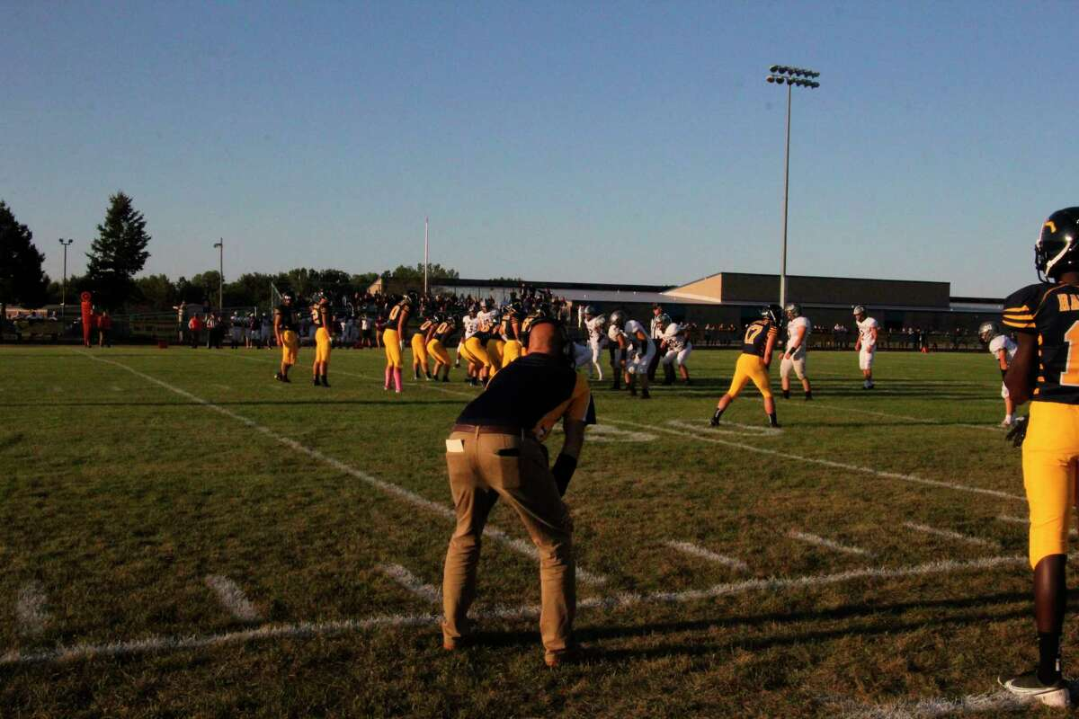 Bad Axe coach Kal Pokley looks on as the Hatchets went for it on fourth down, resulting in a Touchdown, against Cass City. (Tom Greene/Huron Daily Tribune)