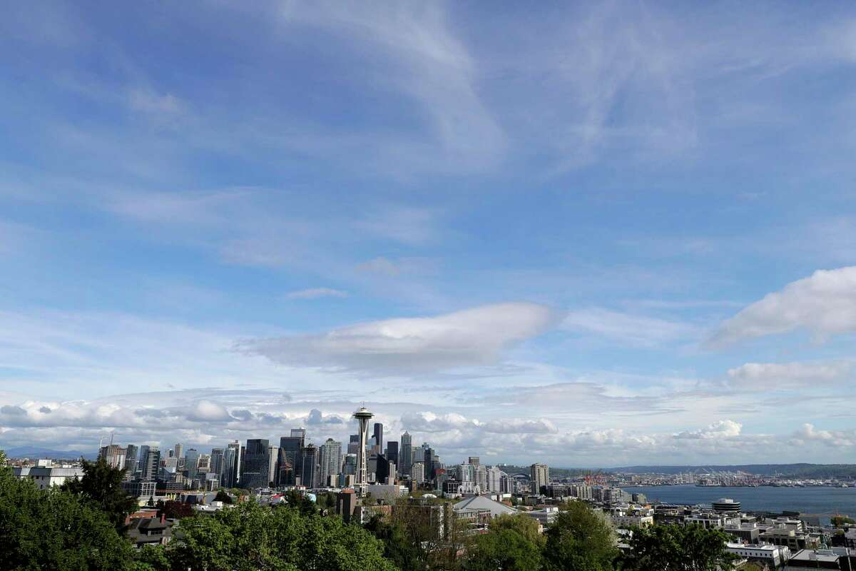 FILE - In this April 30, 2020, file photo, the Space Needle and the Seattle skyline are shown against a blue sky as seen from Kerry Park. (AP Photo/Ted S. Warren, File)