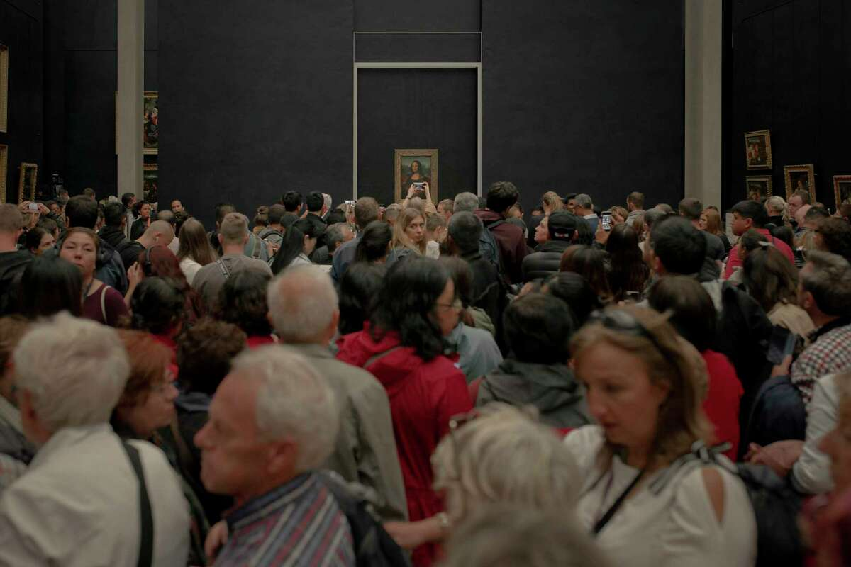PARIS - A crowd of tourists at the Mona Lisa Gallery of the Louvre museum.