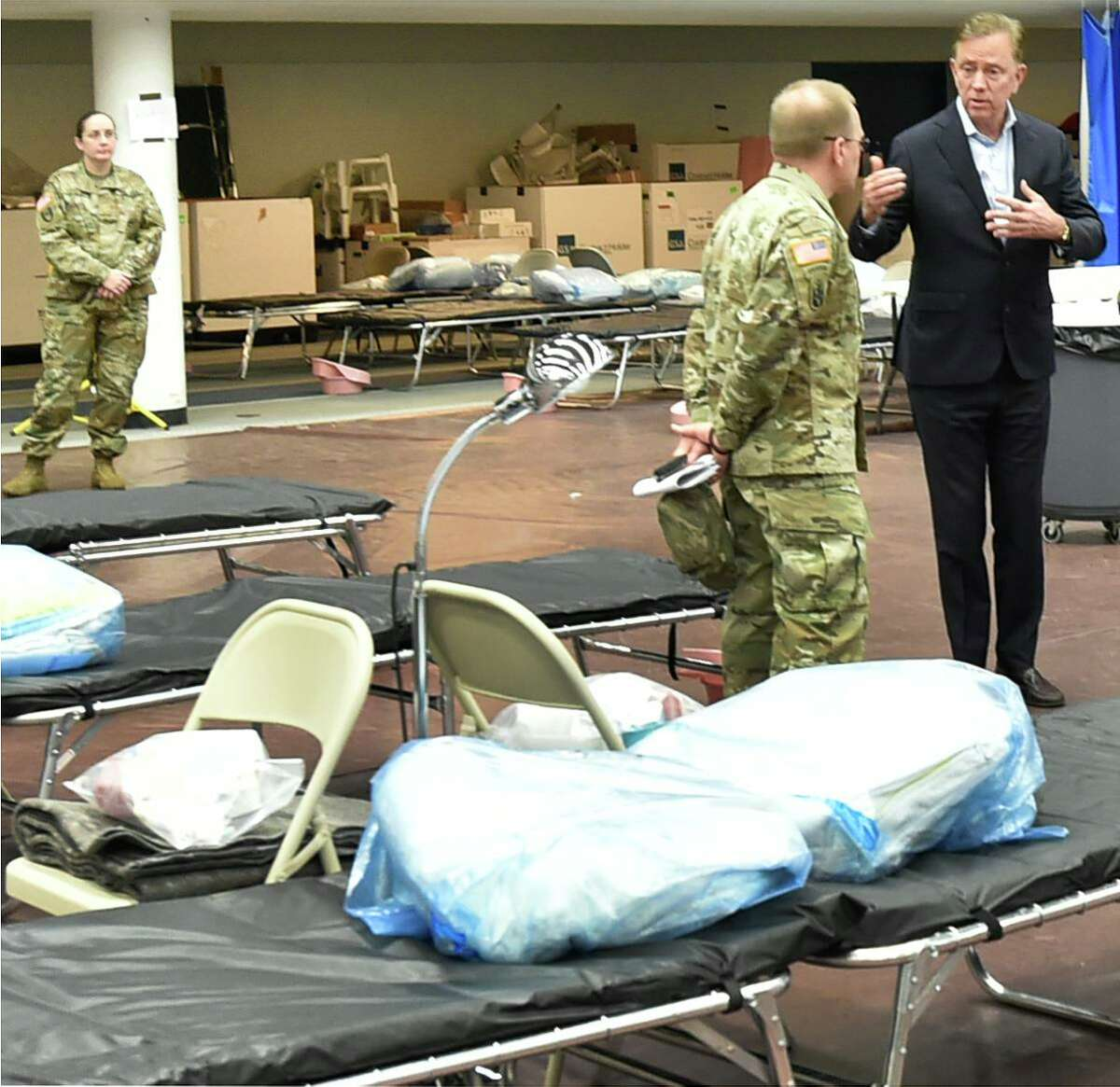 Connecticut Governor Ned Lamont, right, speaks with U.S. Army Major General Francis Evon, the Connecticut National Guard Adjutant General as he tours a Federal Emergency Management Agency 250-bed medical field hospital in April.