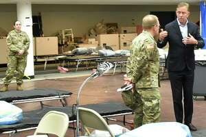 New Haven, Connecticut - Wednesday, April 01, 2020: Connecticut Governor Ned Lamont, right, speaks with U.S. Army Major General Francis Evon, the Connecticut National Guard Adjutant General as he tours a Federal Emergency Management Agency 250-bed medical field hospital Wednesday for non-coronavirus patients staged in the Southern Connecticut State University Moore Field House in New Haven by 75 members of the Connecticut National Guard's 1-102nd Infantry. The site is intended to treat non-COVID-19 patients so there will be more hospital beds people who are impacted by COVID-19 / Coronavirus.