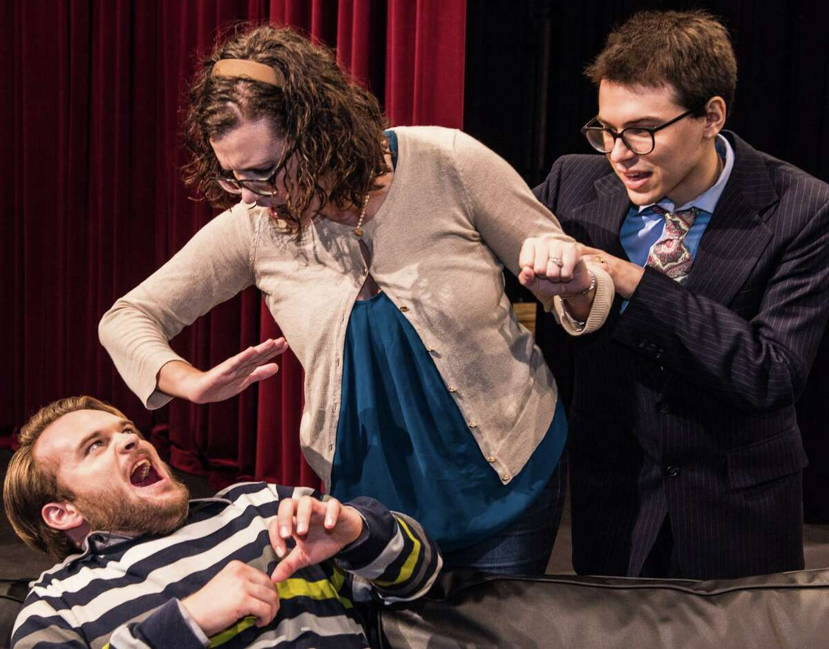 """Alvin Community College students Justin Morgan Brown, left, of Friendswood, Faye Heath, of Angleton, and Cammie Vavich, of Alvin, rehearse a scene from """"God of Carnage."""" Tickets for the production, Oct. 7-9, are available at alvincollege.edu/drama/theatre-season.html."""