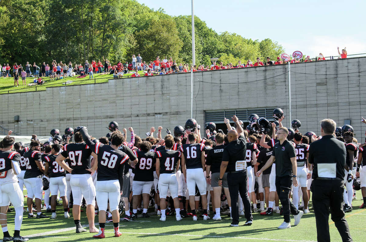 RPI fans sitting outside East Campus Stadium watch the team huddle after a victory over St. John Fisher on Sept. 25, 2021. (Eric Cohen)