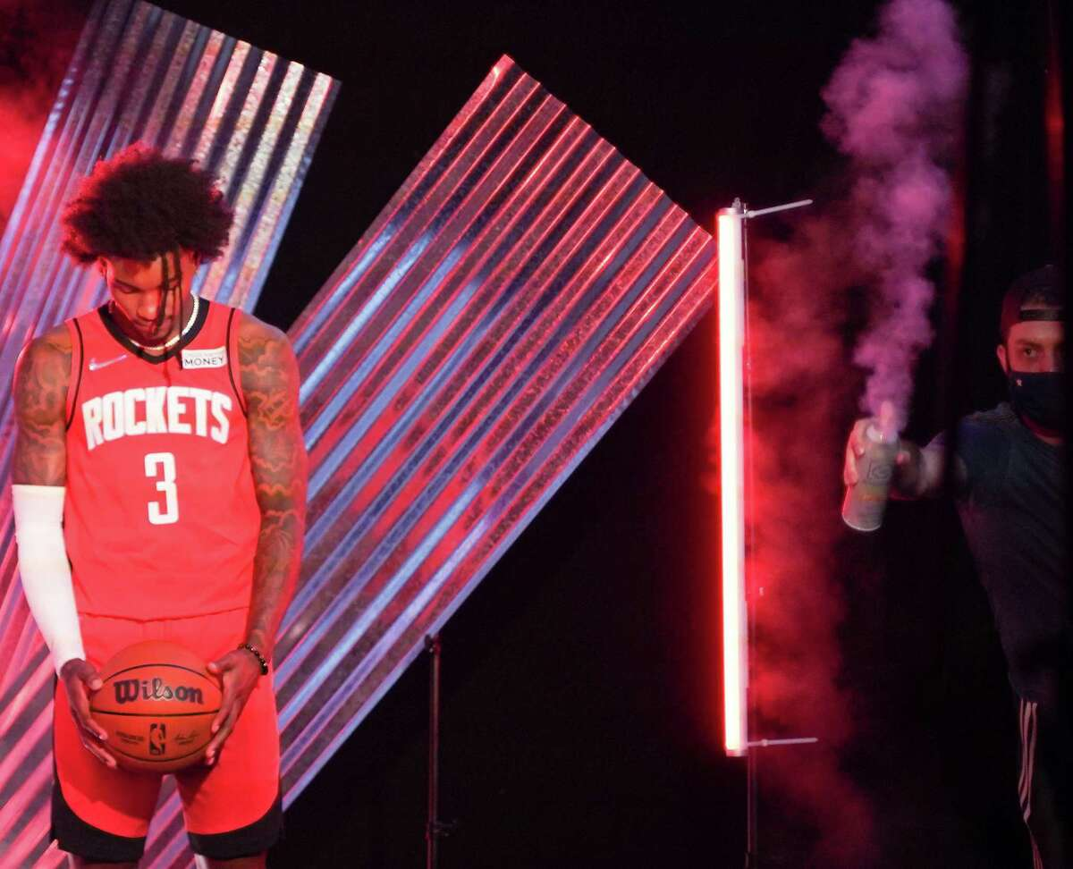 Houston Rockets Kevin Porter Jr., prepares for a video as an assistant sprays smoke during the team's media day in Houston on Monday, Sept. 27, 2021.