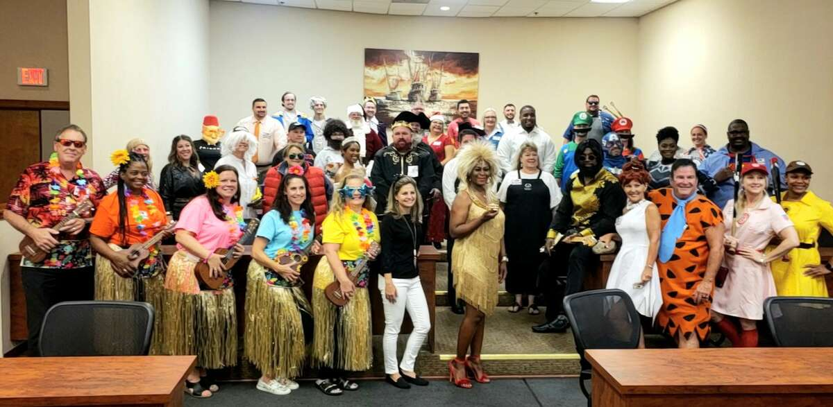 Costumed volunteers gather before a night of service at Alvin Independent School District Education Foundation's annual gala Sept. 18.