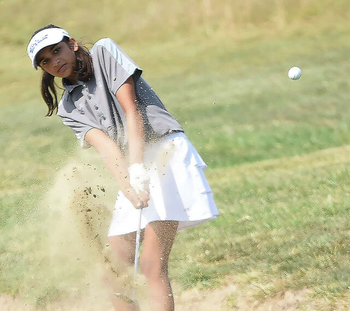 Edwardsville's Ruhee Gupchup escapes the bunker on No. 17 on Thursday in the Class 2A Edwardsville Regional at Oak Brook Golf Club in Edwardsville.
