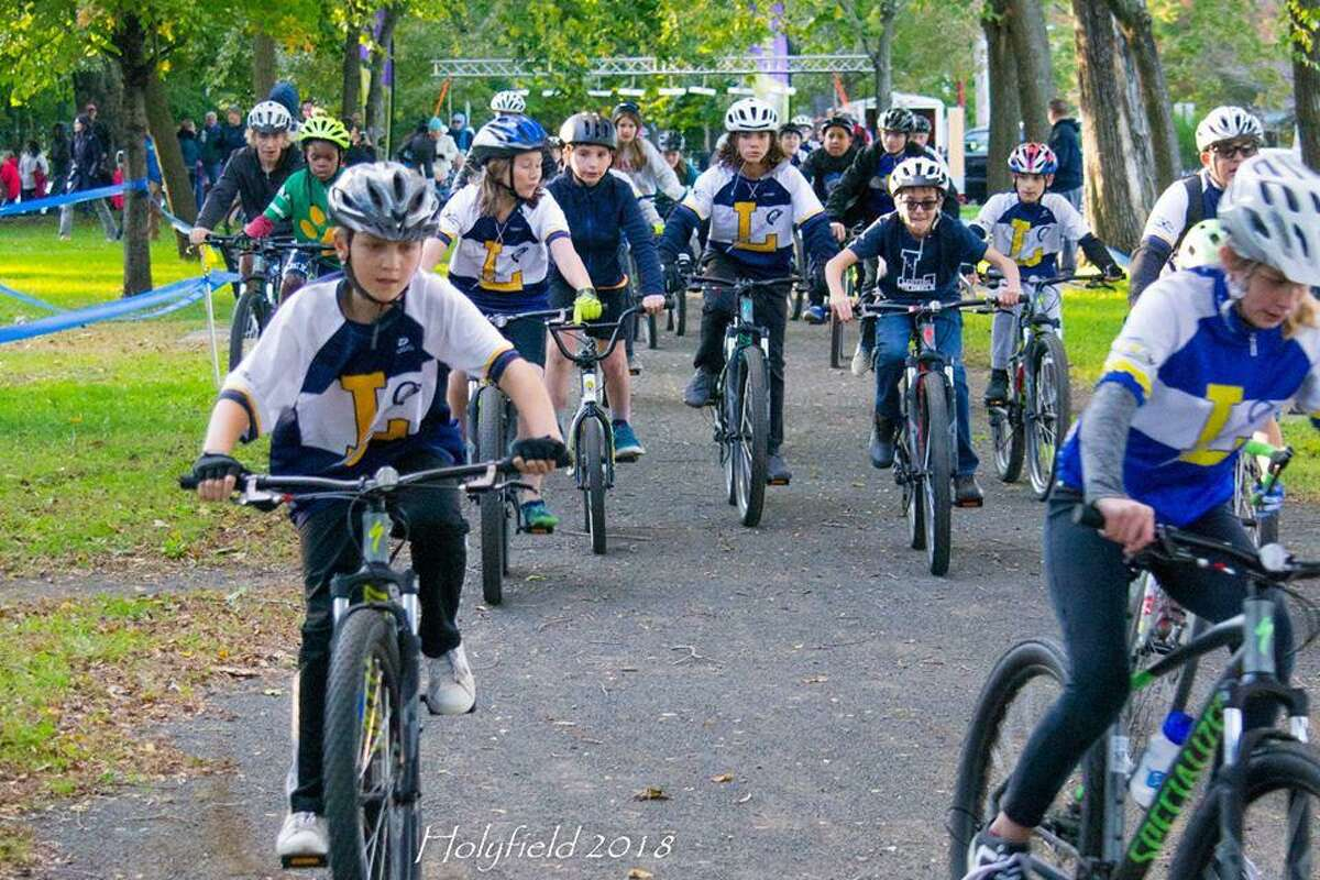Cyclists with the Ledyard Middle School bike club are shown at a race at Edgewood Park.