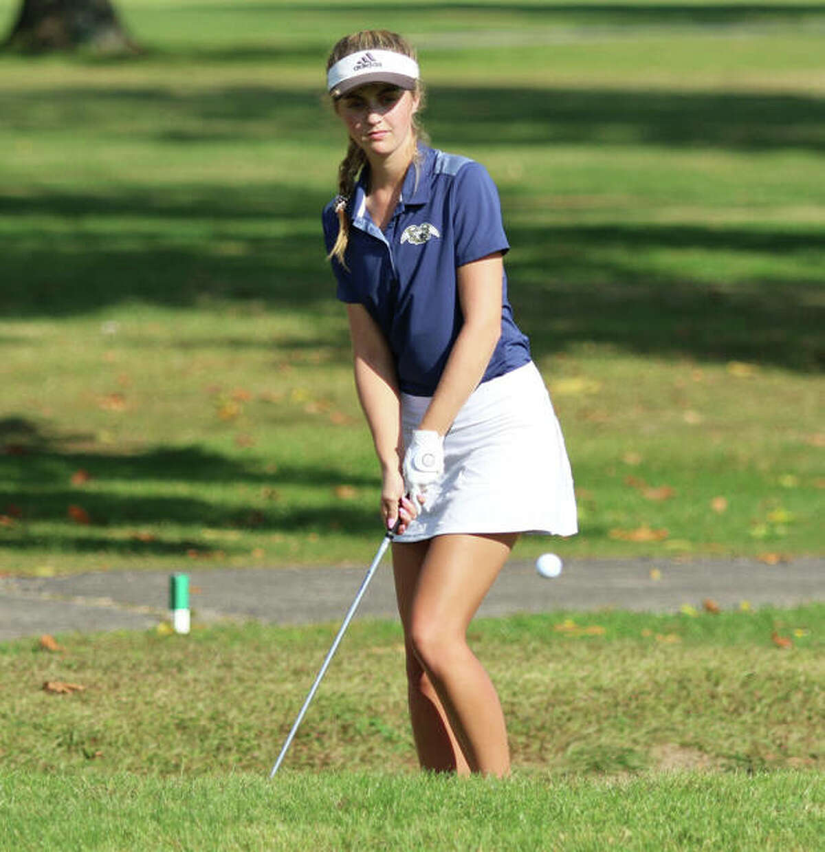 Father McGivney's Ellie Hyten chips her shot on to No. 3 green at Spencer T. Olin Golf Course during the Class 1A Marquette Catholic Regional.