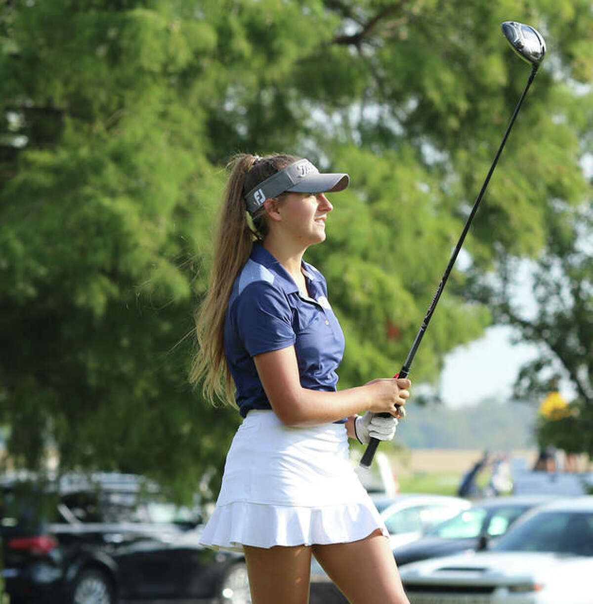 Father McGivney's Grace Stanhaus watches her shot at Spencer T. Olin Golf Course during the Class 1A Marquette Catholic Regional.