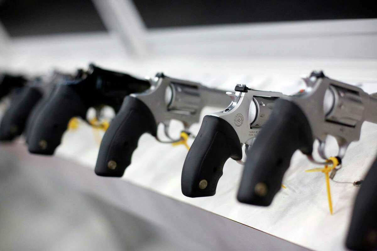A row of revolvers is exhibited at the 2013 NRA annual meetings and exhibits at the George R Brown convention center.