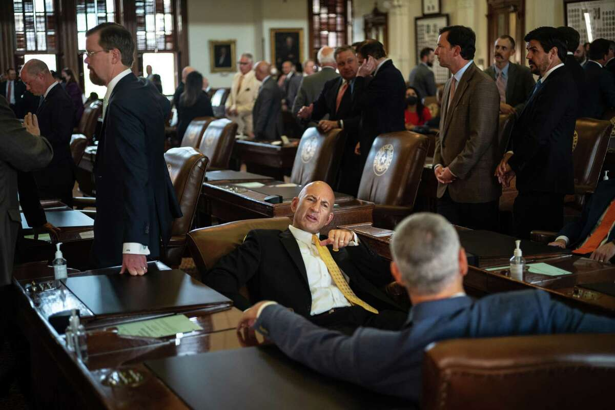 AUSTIN, TX - SEPTEMBER 20: Texas state Rep. Matt Shaheen, R-Plano, speaks with a fellow state representative in the House chamber on the first day of the 87th Legislature's third special session at the State Capitol on September 20, 2021 in Austin, Texas. Following a second special session that saw the passage of controversial voting and abortion laws, Texas lawmakers have convened at the Capitol for a third special session to address more of Republican Gov. Greg Abbott's conservative priorities which include redistricting, the distribution of federal COVID-19 relief funds, vaccine mandates and restrictions on how transgender student athletes can compete in sports. (Photo by Tamir Kalifa/Getty Images)