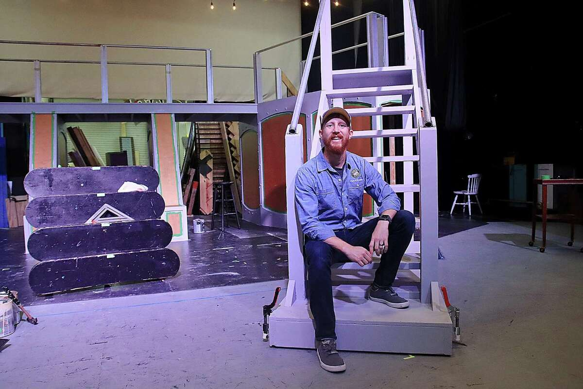 """A retro futuristic set with a moving wall and a staircase is technical director Joe Piper's creation for Art Park Players' production of """"Urinetown: The Musical"""" on weekends Oct. 8-23."""