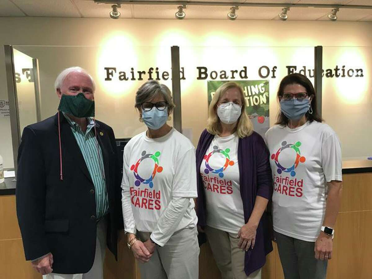 Left to right: Coalition members Phil Dwyer, Cathy Hazlett, Reini Knorr and Cristin McCarthy Vahey are all smiles behind their safety masks after the Fairfield Board of Education unanimously voted to accept the CDC Drug Free Communities Grant.