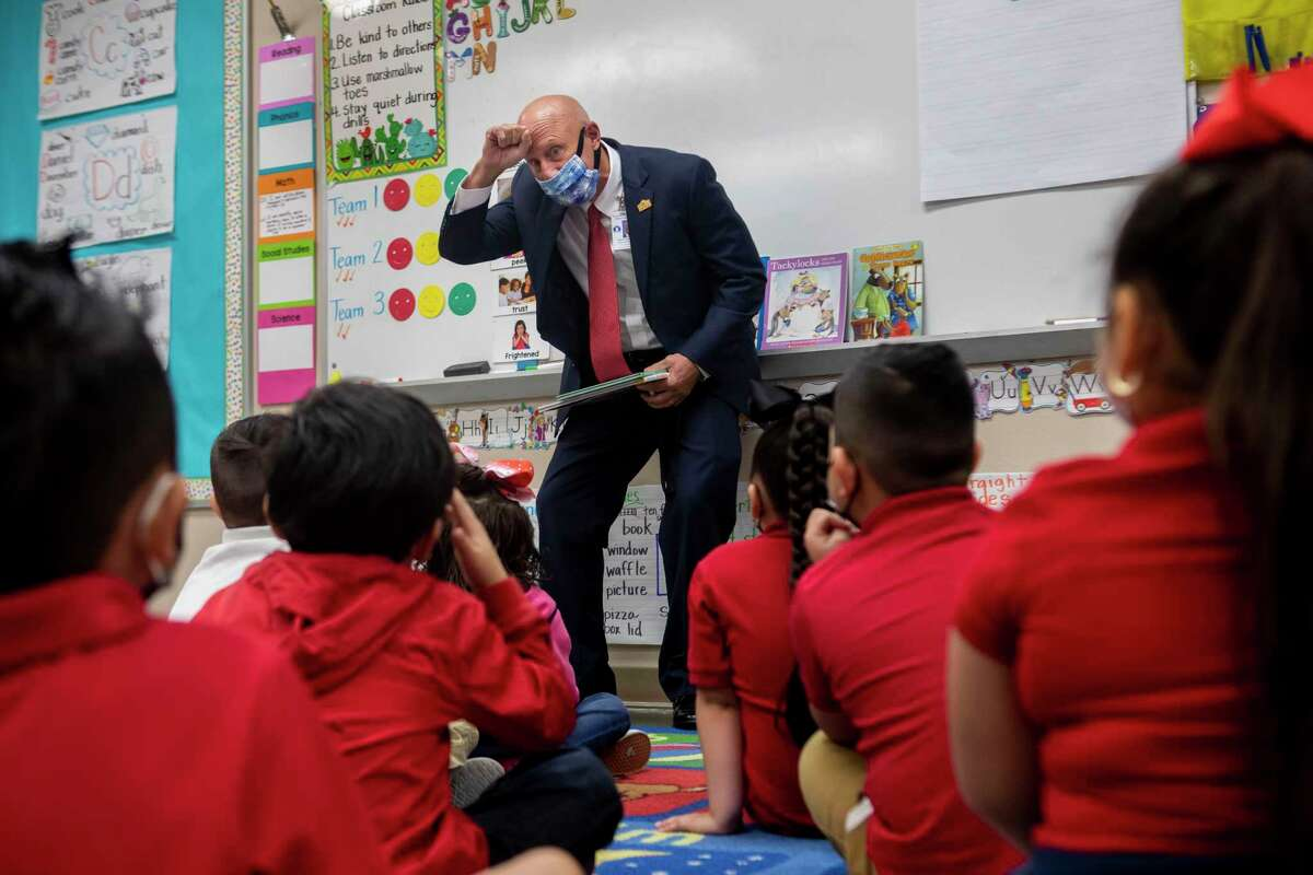 SAISD Interim Superintendent Robert Jaklich reads to a kindergarten class Thursday at Wilson Elementary School.
