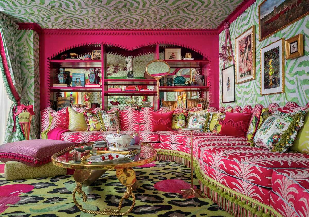 This Moulin Rouge Media Room, designed by Houston interior designer Courtnay Elias and her team at Creative Tonic used cherry red - including cherries woven into the carpet - and apple green, plus a little animal print, too. Texture comes in tassels, fringe and other upholstery embellishments.