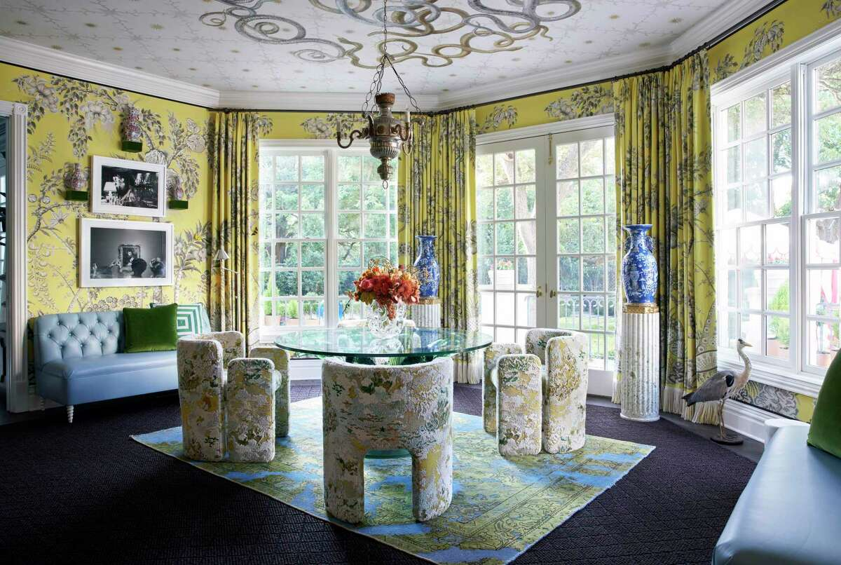 1. If show houses offer ideas and information on design trends, the top trend you'll see here is color. Houston interior designer Dennis Brackeen's morning room is a good example of both strong colors and a maximalist approach to design. He uses Jim Thompson Palampore wallpaper in bright yellow (citron) with a chinoiserie pattern along with matching draperies. Custom made chairs in Kravet's Edent upholstery surround a Lalique cactus table.