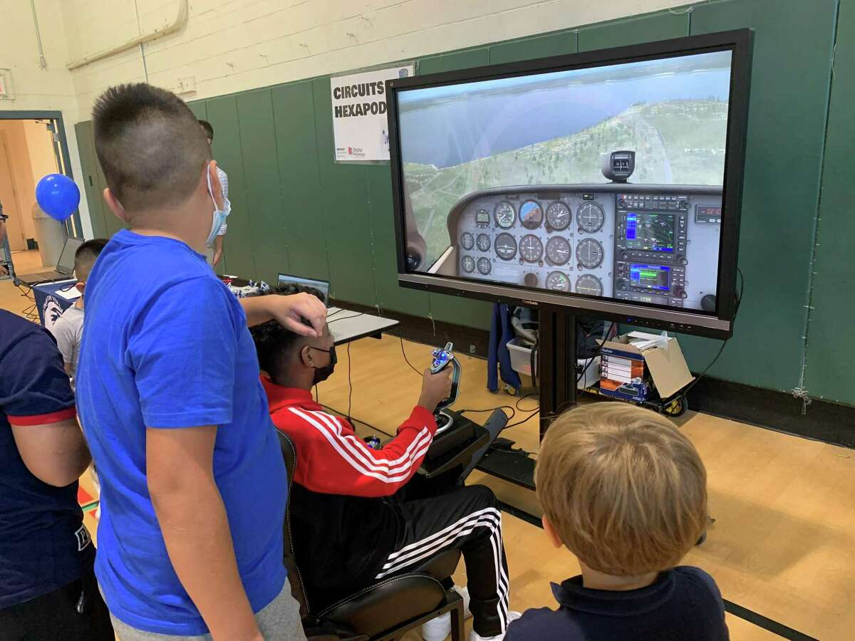 Ponus Ridge STEAM Academy held a carnival to celebrate the arrival of new Chromebooks for all its students. In the gym, students could explore different STEM activities such as a flight simulator and Sphero robots.