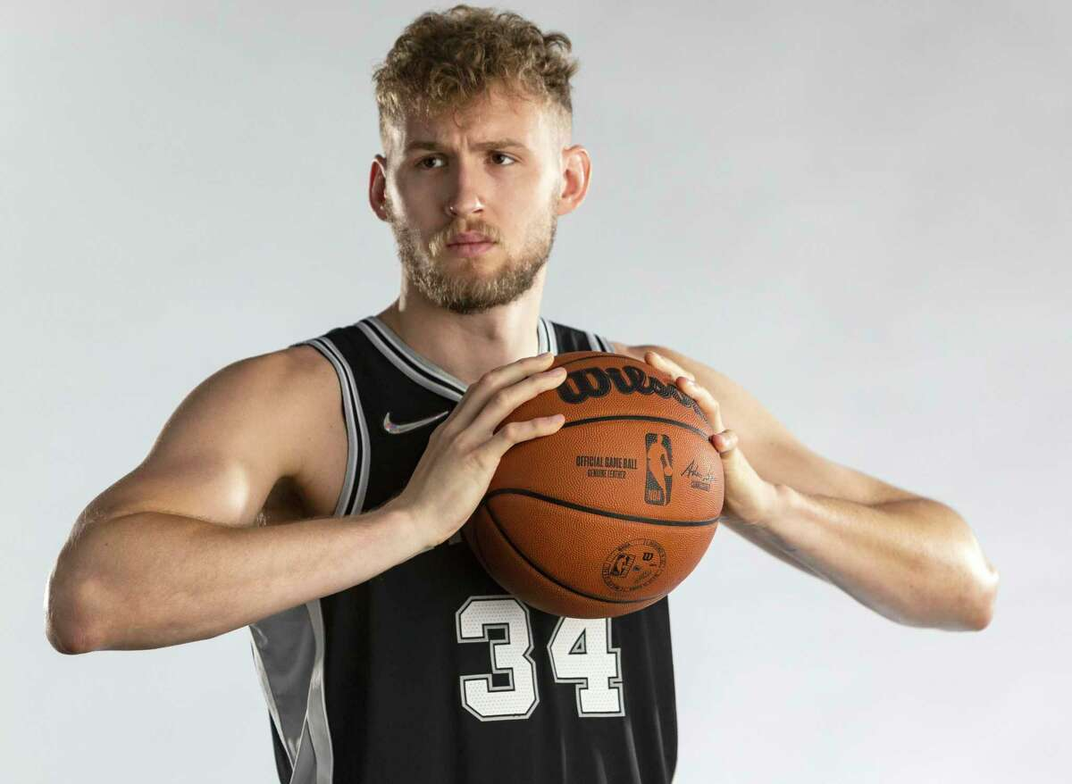 Spurs center Jock Landale poses for photos Monday, Sept. 27, 2021 at the Spurs practice facility during the team's media day.