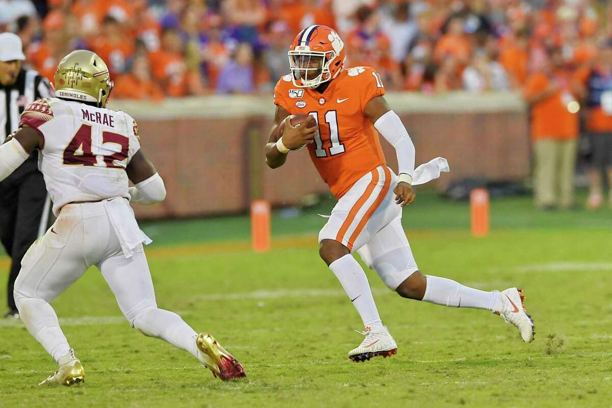 Clemson quarterback Taisun Phommachanh (11) rushes out of the backfield while defended by Florida State's Jaleel McRae during the second half of an NCAA college football game Saturday, Oct. 12, 2019, in Clemson, S.C. (AP Photo/Richard Shiro)