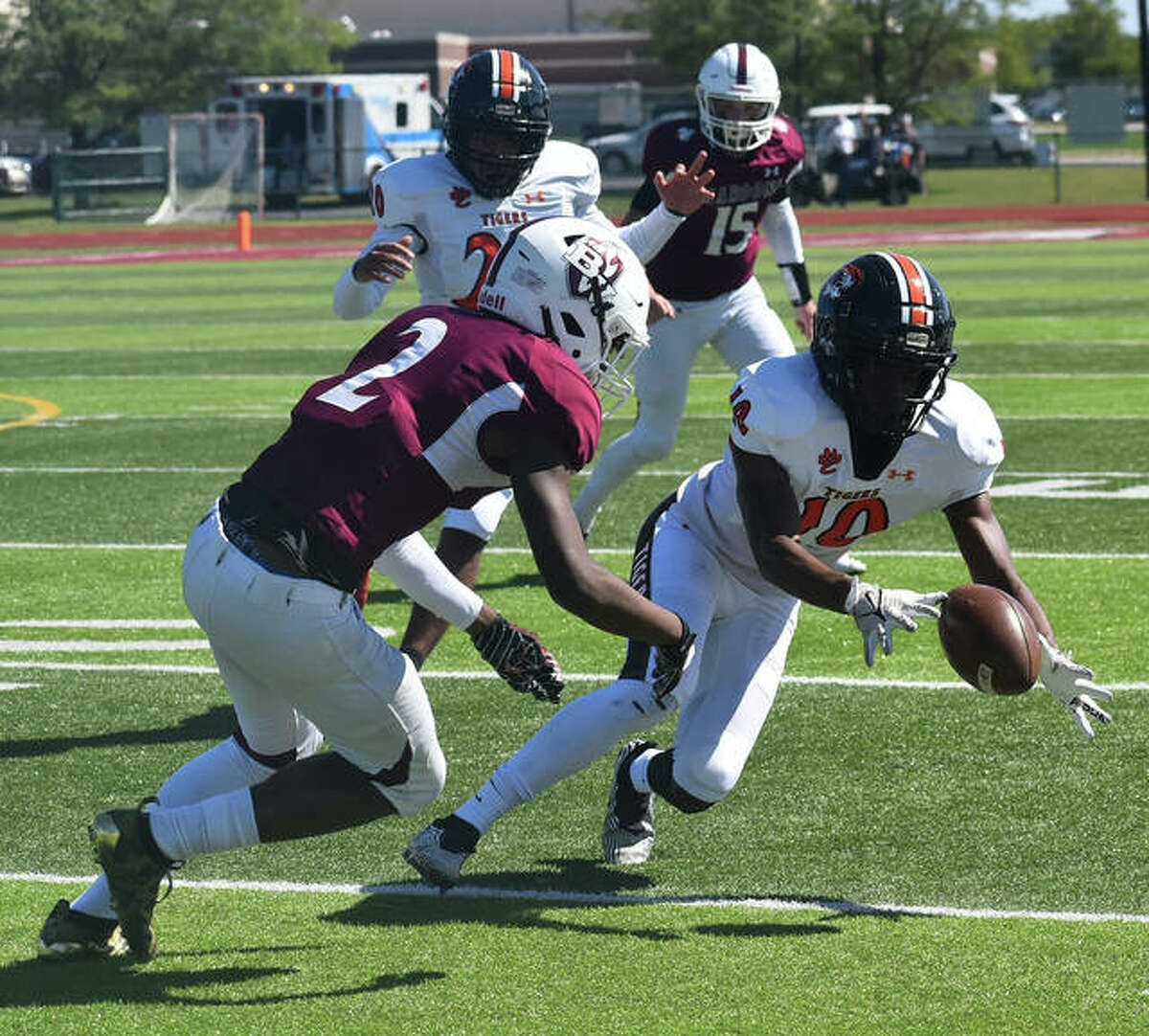 Edwardsville's Johnnie Robinson nearly recovers a kickoff during the first quarter against Belleville West.