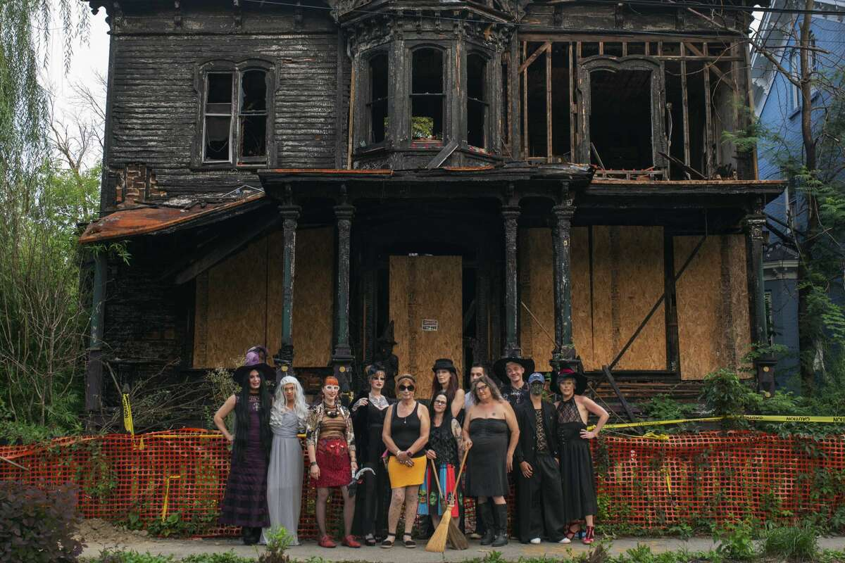 """Members of Poughkeepsie's Witchcraft District community in front of Joe Mendillo's """"Halloween House,"""" which stood for nine months following an arson fire in January. It was bulldozed in September."""