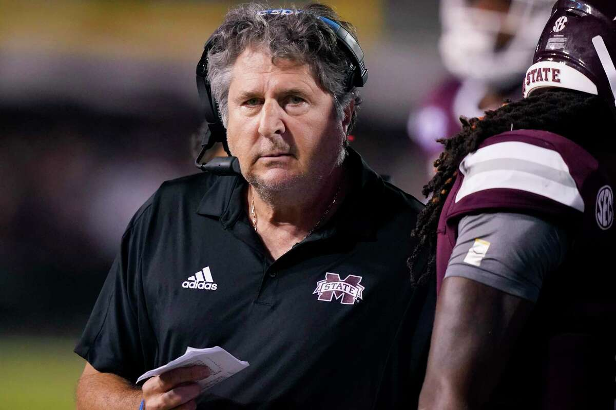 Mississippi State head coach Mike Leach walks among players during the second half of an NCAA college football game in Starkville, Miss., Saturday, Sept. 11, 2021. Mississippi State won 24-10. (AP Photo/Rogelio V. Solis)