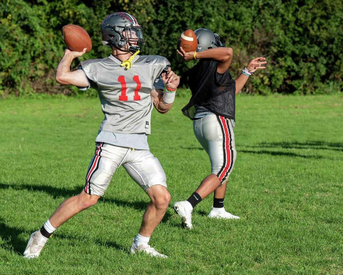 Niskayuna High quarterback Dan Quinn (No. 11) and backup quarterback Buddy Owens run drills during a practice at Niskayuna High School on Tuesday, Sept. 28, 2021. (Jim Franco/Special to the Times Union)