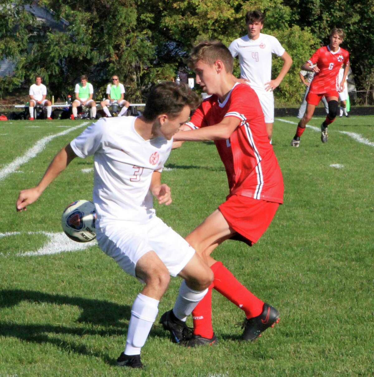 Big Rapids senior Ethan Fuller (left) and Reed City sophomore Isaac Clementshaw battle for possession of the ball during Thursday afternoon's soccer match. (Pioneer photo/Joe Judd)