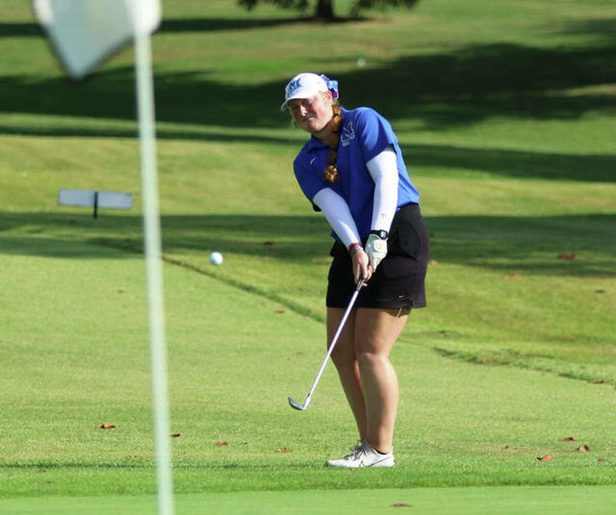 Marquette Catholic's Grace Piar chips onto the green on hole No. 1 at Belk Park in Thursday's Class 1A regional in Wood River. Piar bogey the hole, but came back with 30 on the back nine to win the regional with a school-record 7-under par 65.