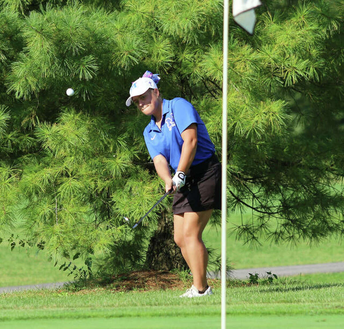 Marquette Catholic's Audrey Cain chips onto the first green in Thursday's Class 1A regional at Belk Park in Wood River. Cain shot 77 to finish second in the regional.