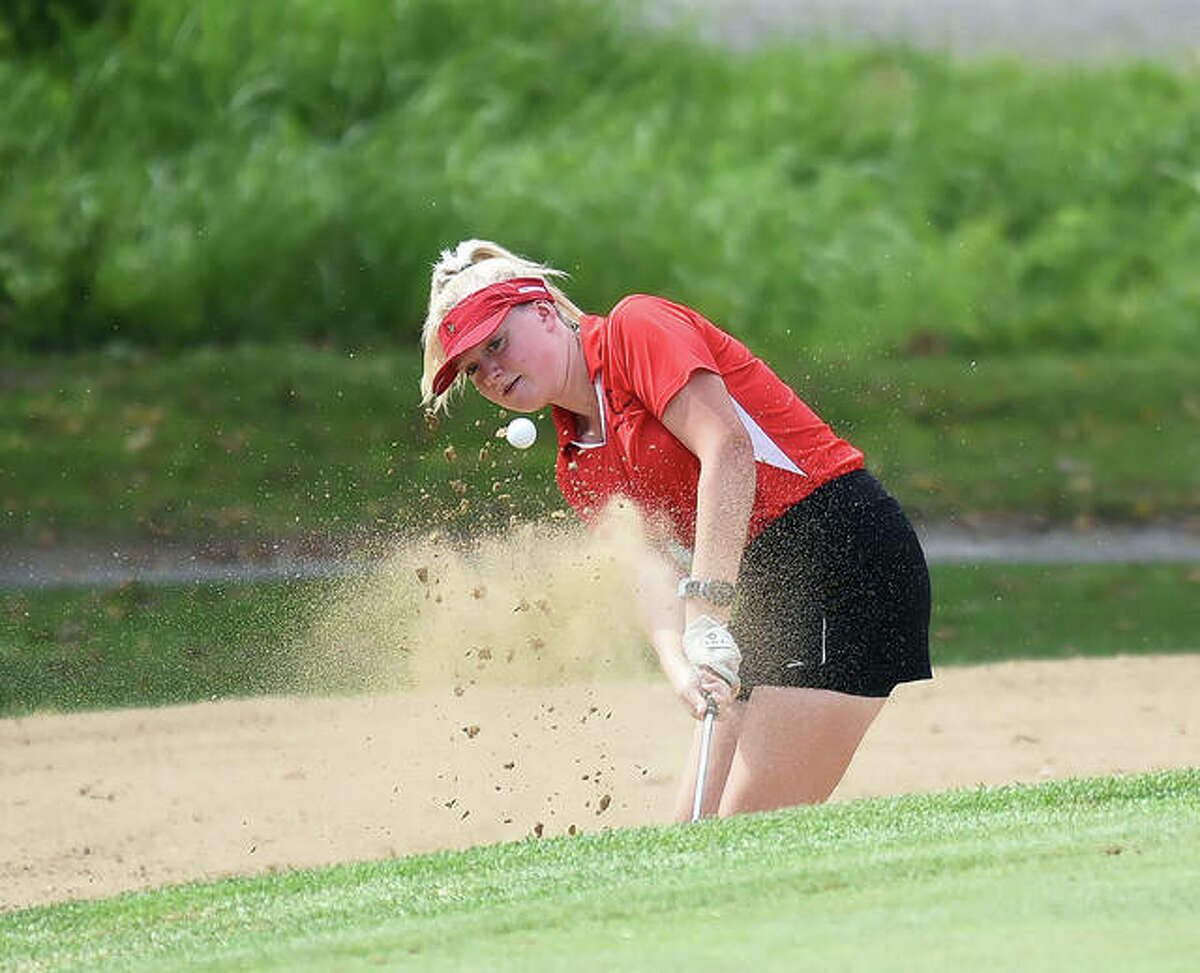 Alton's Alexia Paulin hits out of the bunker on No. 4 at Oak Brook Golf Club during the Class 3A Edwardsville Regional on Thursday.