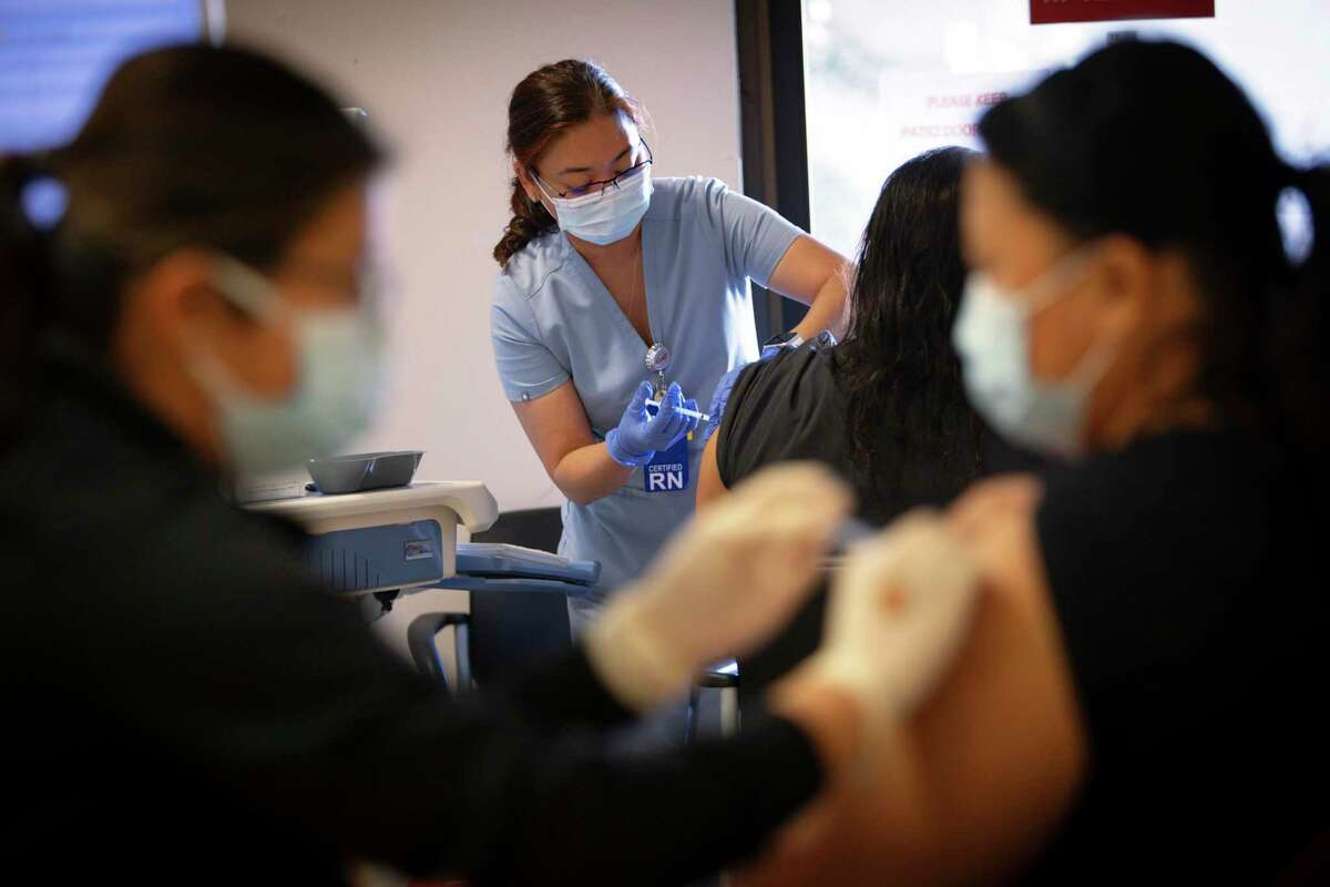 Santa Clara Valley Medical Center health care workers receive their COVID vaccine booster shots on Thursday. As vaccination rates edge up and boosters top off immunity, hopes are rising for an end to the pandemic roller coaster ride.