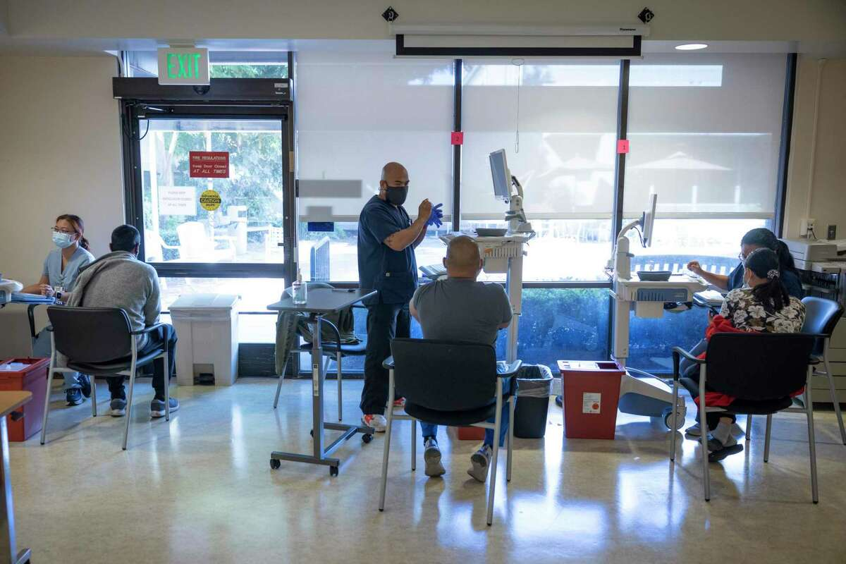 Santa Clara Valley Medical Center health care workers receive their COVID-19 booster shots.